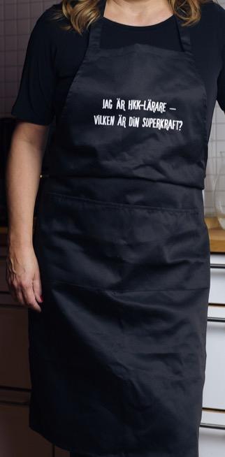Förkläde: Jag är HKK-lärare – vad är din superkraft? (svart)